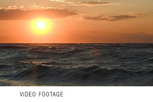 Golden sunset over rough sea