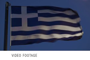 Greek flag fluttering against