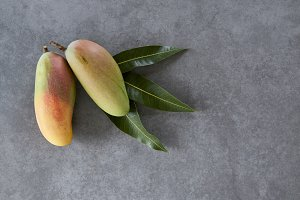 thai mango on wooden background