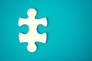 Jigsaw on blue background