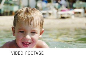 Little boy swimming on board near
