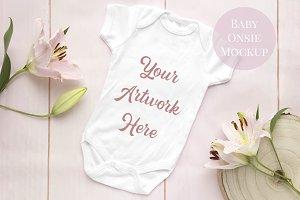 Baby Onsie mockup - pink wood