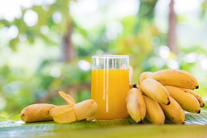 Bunch of bananas leaf smoothie juice drink glass