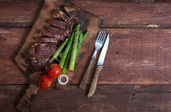 Grilled Beef Steak With Vegetables On A Wooden Rustic Background With Copy Space