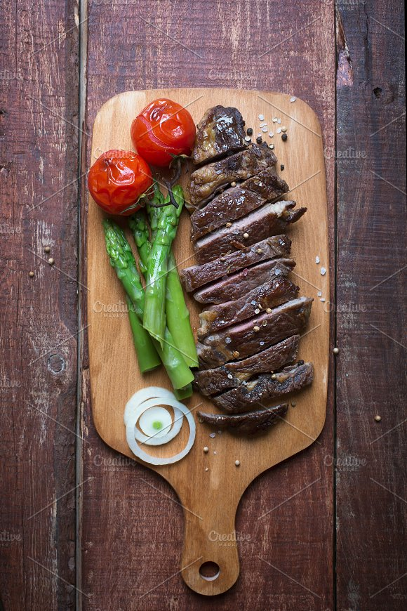 Grilled Beef Steak On A Light Chopping Board Wooden Rustic Background
