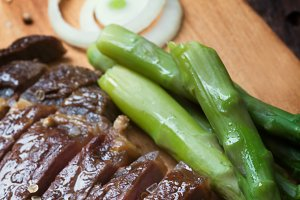 Grilled beef steak on a wooden rustic background