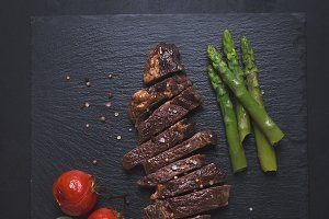 Grilled beef steak on a black background
