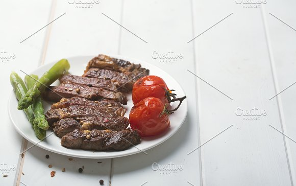 Grilled Beef Steak On A White Plate And White Background