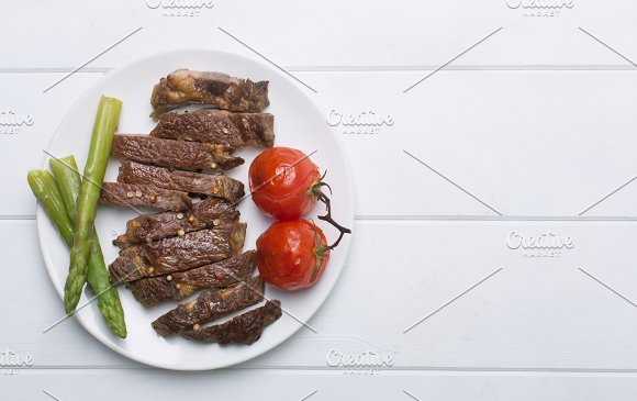 Grilled Beef Steak On A White Plate And White Background Flat Lay And Copy Space
