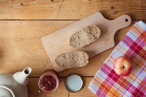 Breakfast composition on wooden background.