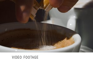 Putting  sugar into cup with coffee