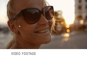 Smiling woman in sunglasses outdoor