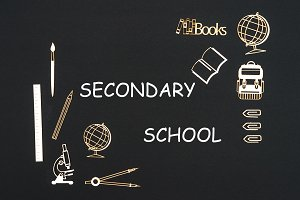 School supplies placed on black background with text secondary school