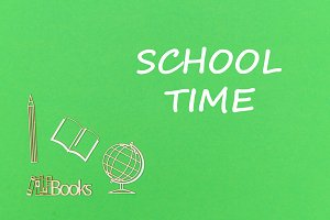 text school time, school supplies wooden miniatures on green background