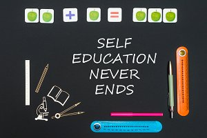 Above stationery supplies and text self education never ends on blackboard