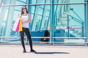 Happy girl enjoys shopping