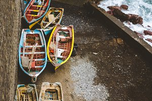 Local traditional fishing boats under shelter during storm in atlantic ocean. View from above, view top-down. Sinagoga location on Santo Antao Island. Cape Verde