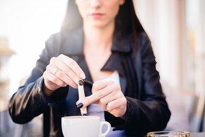 Woman will sweeten her coffee