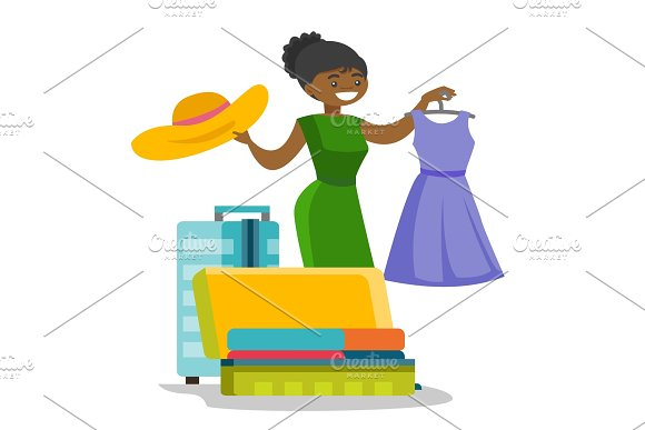 African-american Woman Packing Clothes In Suitcase