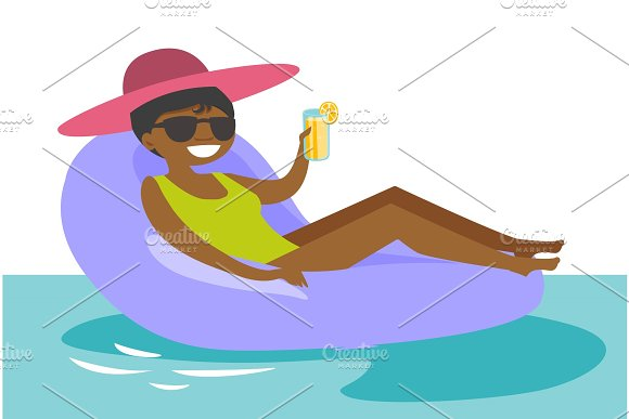 African-american Woman Relaxing In Swimming Pool