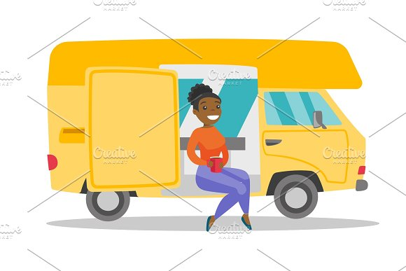 Young African Woman Drinking Coffee In Motorhome