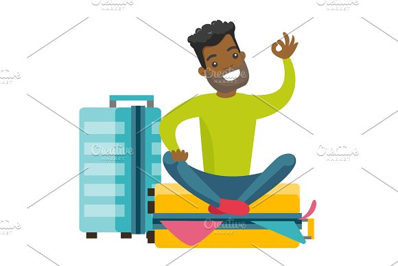 Young African-american Man Sitting On Suitcase