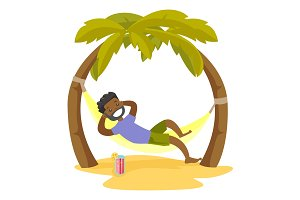 African-american man lying in hammock on the beach