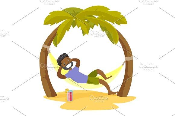 African-american Man Lying In Hammock On The Beach
