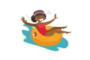 African-american woman having fun in waterpark.