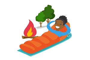 African-american woman sleeping in a sleeping bag.