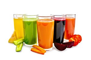 Juice vegetable in glasses isolated