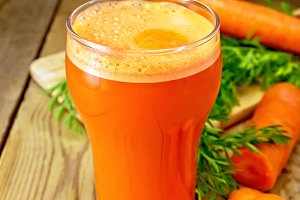 Carrot juice in tall glass