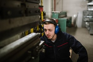 Young handsome male engineer working