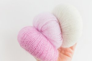balls colorful fluffy yarn in hand