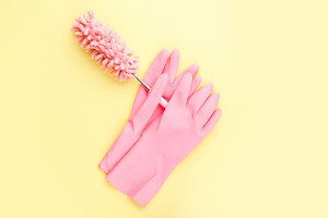 pink gloves hold a soft brush