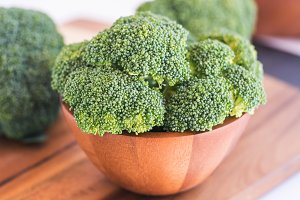 Fresh broccoli in wooden bowl