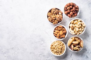 Nuts assortments on stone table top view.