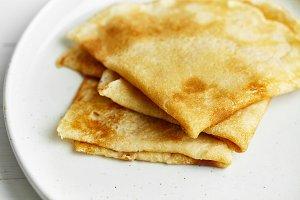 Macro shot of pancakes in white plate