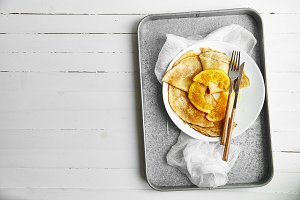 Overhead image of pancakes in white plate