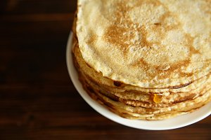 Stack of pancakes with orange jam and honey