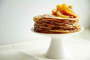 Crepes cake with orange jam and honey