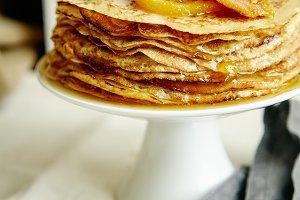 Crepes cake with orange jam and honey