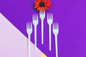 forks with orange flower