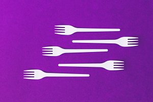 Plastic forks on  purple