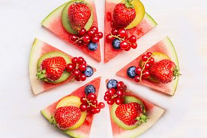 Sliced watermelon pizza with fruits