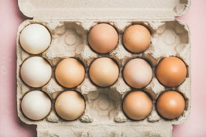 Natural colored eggs for Easter in box, horizontal composition