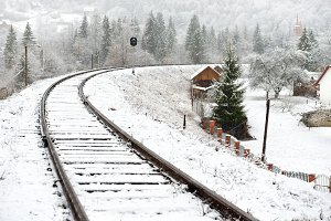 Winter landscape with rails track