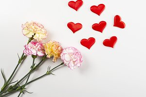 White and pink flower background next to yellow flowers and hearts on white background. Copy space. Mockup.