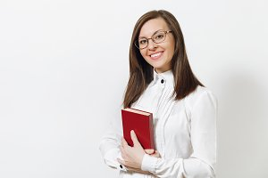 Beautiful happy caucasian young smiling brown-hair business woman in white shirt, glasses with book isolated on white background close up. Manager, worker or student. Copy space for advertisement.