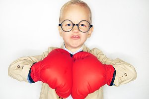 Boy in gloves looking aggressively at camera